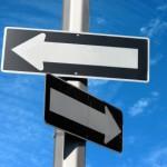 2 arrow signs blue sky